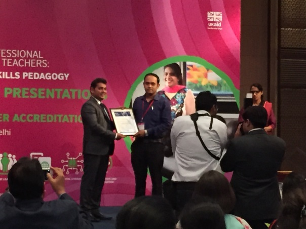 Mr. Dibya Prasad Satapathy, Head - Science Department/ Biology Teacher Receiving the Global Teacher Accreditation confider by the British Council